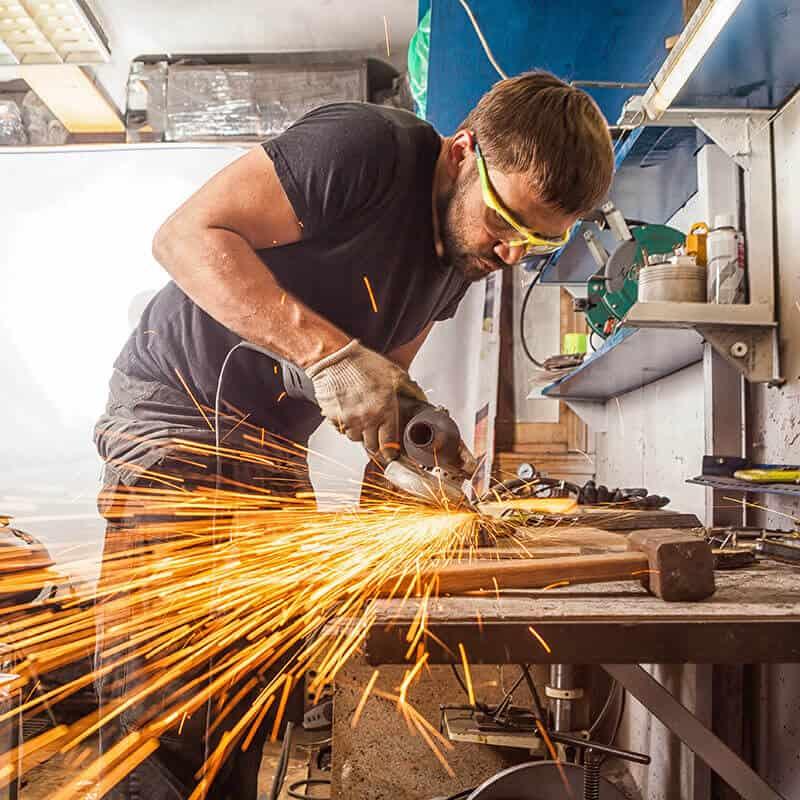 man working in a loud shop